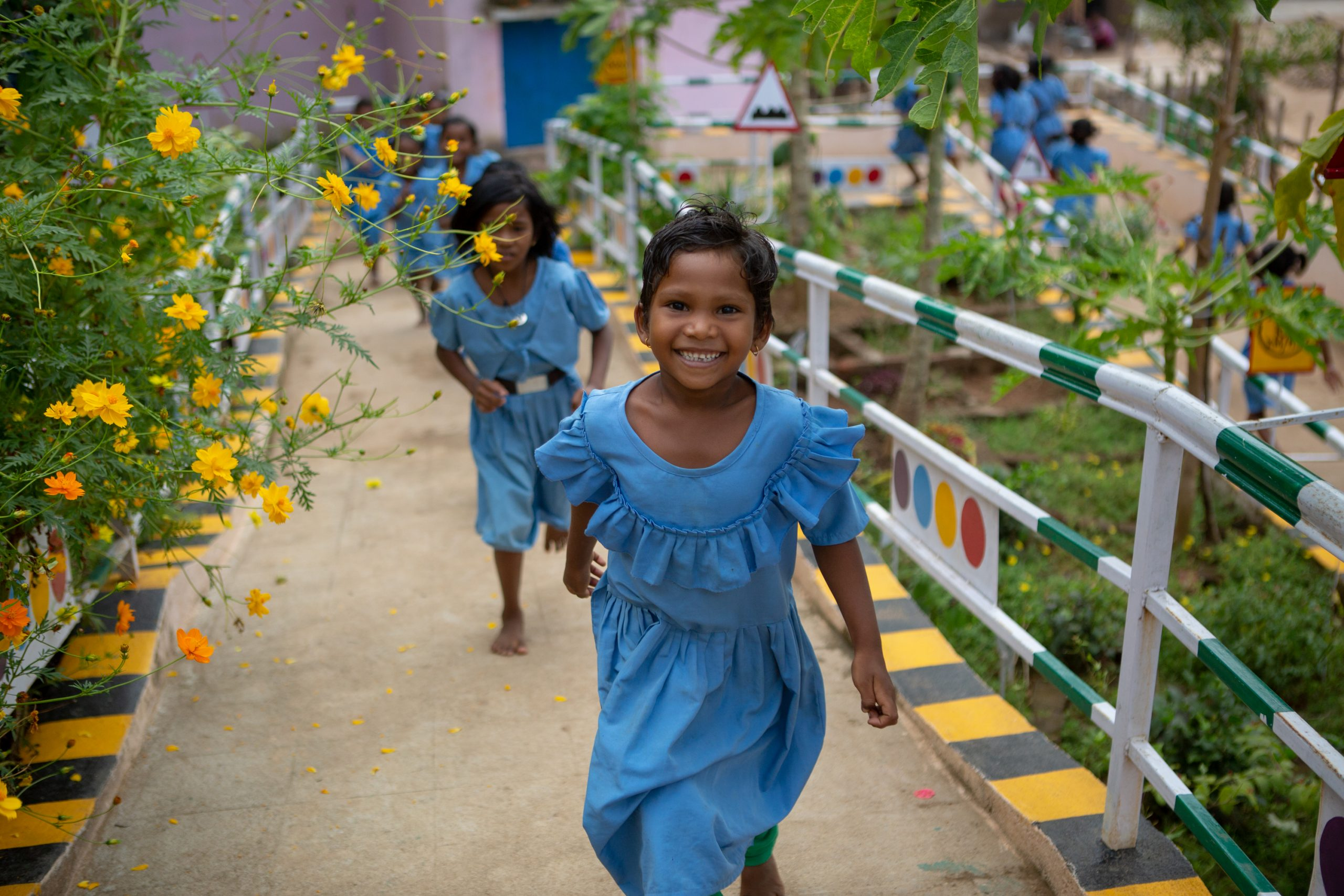 Deepika Jakaka, a 1st grader, plays with her classmates at the wonderfully green courtyard of the Ramachandrapur upper primary school in Rayagada district, Odisha. With so much of greenary surrouding the school, the children remain stress free and encouraged to learn. © UNICEF/UN0267942/Akhbar Latif